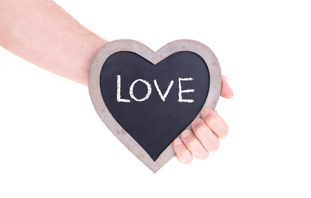 Adult holding heart shaped chalkboard - Isolated on white