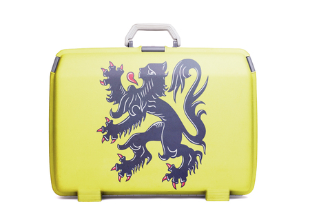 Used plastic suitcase with stains and scratches, printed with flag - Flanders