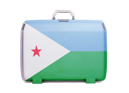 Used plastic suitcase with stains and scratches, printed with flag, Djibouti