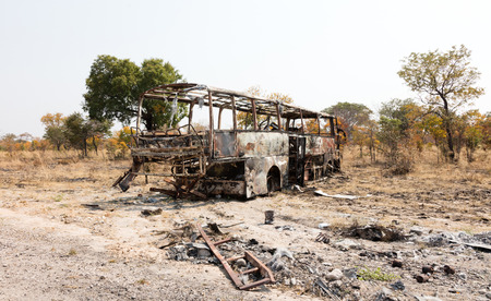 Burned bus at the side of the road, Botswana