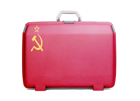 Used plastic suitcase with stains and scratches, printed with flag - USSR Stock Photo