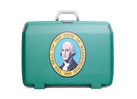 Used plastic suitcase with stains and scratches, printed with flag, Washington