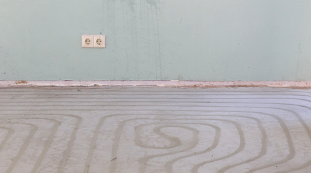 Water underfloor heating pipes in a concrete floor