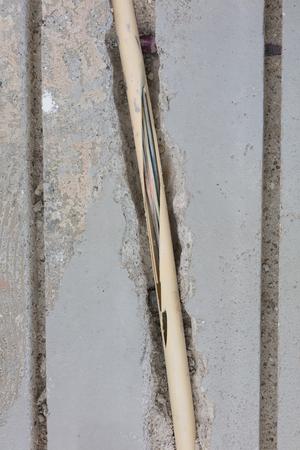 Broken wire in the floor, installing underfloor heating Stock Photo