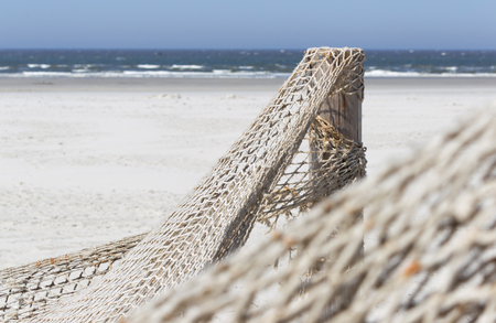 Fishnet on a beach in the Netherlands