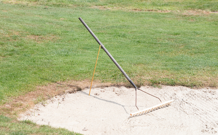Golf: sand trap on the green grass, the Netherlands