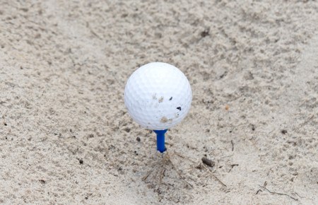 Golf ball waiting to be used, sand