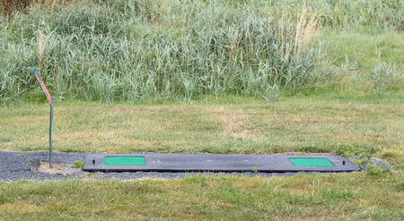 Empty driving range on a dutch pitch and putt court