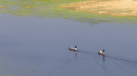 Mokoro safari in Botswana - Tourists in the Okavango delta
