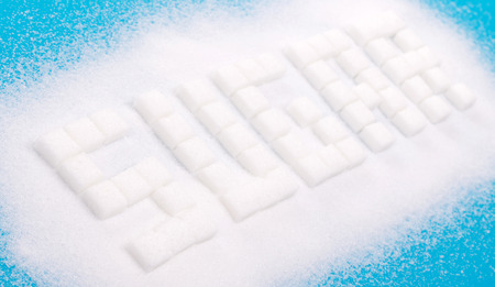 White sugar cubes background - Concept of unhealthy eating