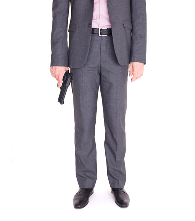 Man in suit with gun, isolated on white 版權商用圖片