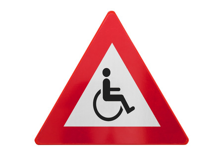 Traffic sign isolated - Man in wheelchair - On white Foto de archivo