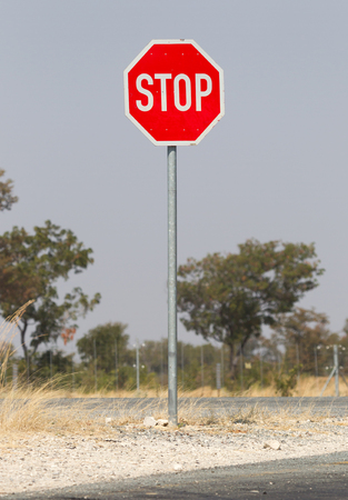Stop sign at the side of the road, Namibia