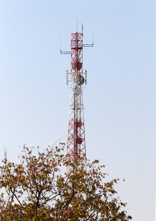 Cell phone tower or mobile cell site with blue sky background - Botswana