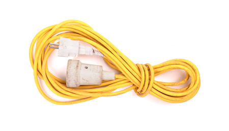Yellow extension cord isolated on white background 写真素材