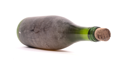 Old bottle of wine, covered in dust, selective focus, isolated on white