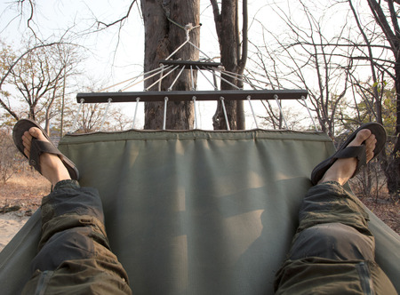 Men feet in Hammock, relaxing in the bush - Botswana Stok Fotoğraf