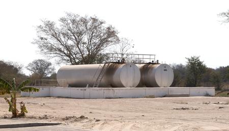 Huge gas tanks nearby a gas station Foto de archivo - 118834227