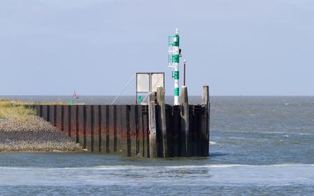 Harbour green starboard marker - Navigation light - Dutch harbour Stok Fotoğraf