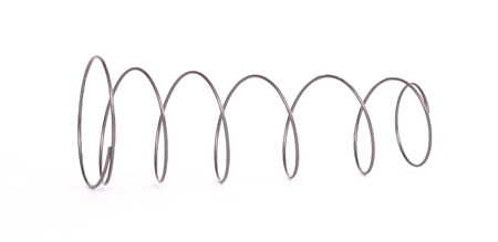 Coil spring, isolated on a white background Stock Photo