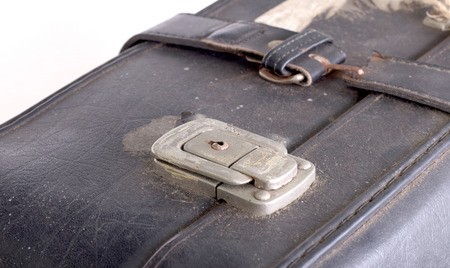 Old vintage hard suitcase with metal latch lock
