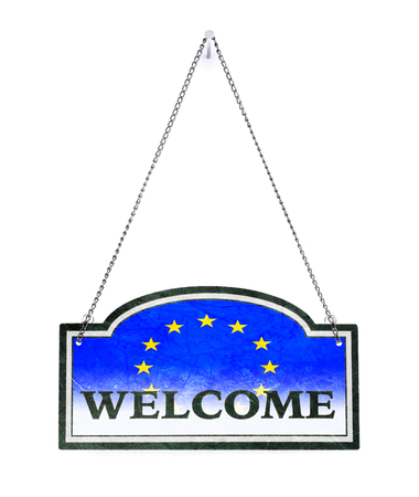 The EU welcomes you! Old metal sign isolated on white