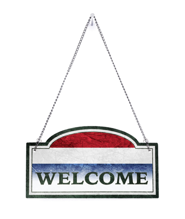 The Netherlands welcomes you! Old metal sign isolated on white