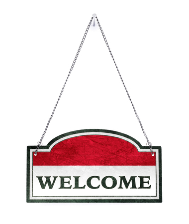 Indonesia welcomes you! Old metal sign isolated on white