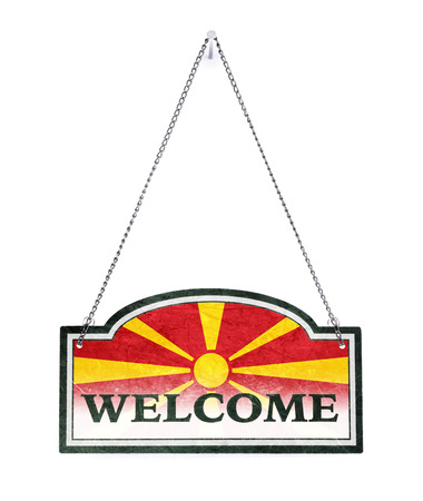 Macedonia welcomes you! Old metal sign isolated on white