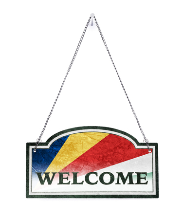 The Seychelles welcomes you! Old metal sign isolated on white