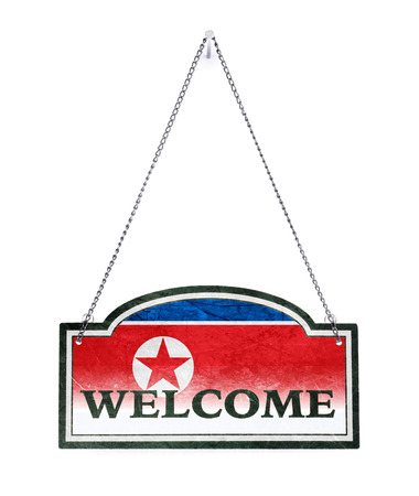 North Korea welcomes you! Old metal sign isolated on white