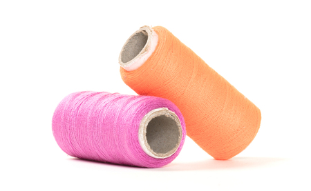 Two sewing thread isolated on a white background
