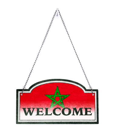 Morocco welcomes you! Old metal sign isolated on white