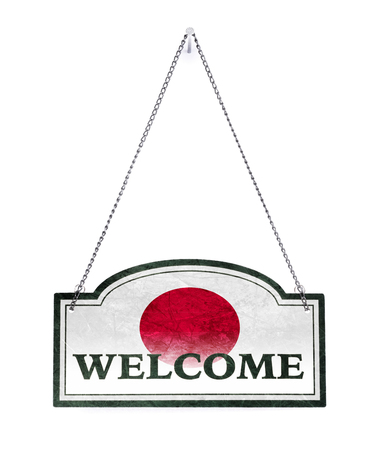 Japan welcomes you! Old metal sign isolated on white Banco de Imagens
