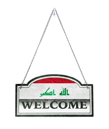 Iraq welcomes you! Old metal sign isolated on white Banco de Imagens