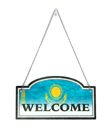 Kazakhstan welcomes you! Old metal sign isolated on white