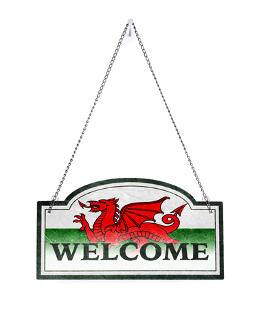 Wales welcomes you! Old metal sign isolated on white 免版税图像
