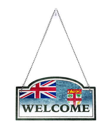 Fiji welcomes you! Old metal sign isolated on white
