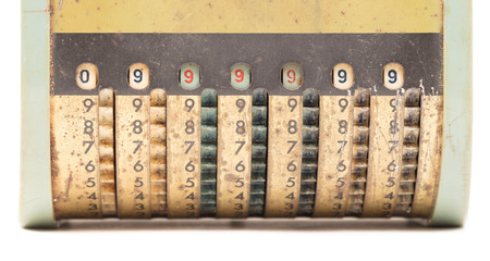 Vintage manual adding machine isolated on white Banque d'images