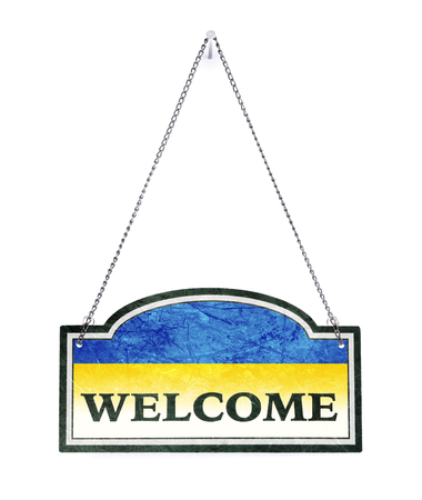Ukraine welcomes you! Old metal sign isolated on white Banco de Imagens