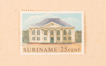 Suriname - CIRCA 1970: A stamp printed in Suriname shows a large house, circa 1970 写真素材