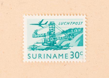 Suriname - CIRCA 1970: A stamp printed in Suriname shows industrialization circa 1970