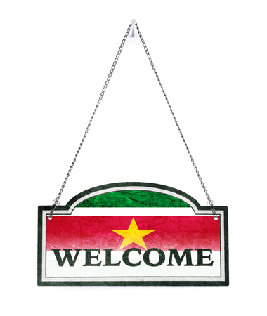 Suriname welcomes you! Old metal sign isolated on white Banco de Imagens