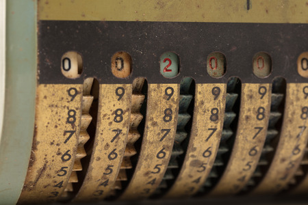 Vintage manual adding machine isolated on white, selective focus - 200 Banco de Imagens