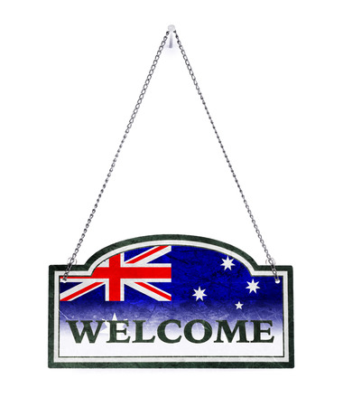 Australia welcomes you! Old metal sign isolated on white 免版税图像