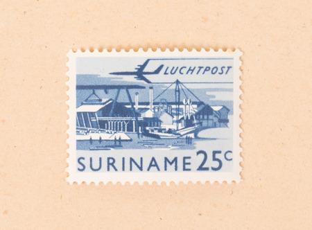 Suriname - CIRCA 1970: A stamp printed in Suriname shows a harbour, circa 1970 写真素材