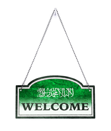 Saudi Arabia welcomes you! Old metal sign isolated on white Imagens - 121676043
