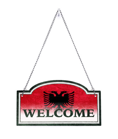 Albania welcomes you! Old metal sign isolated on white Banco de Imagens