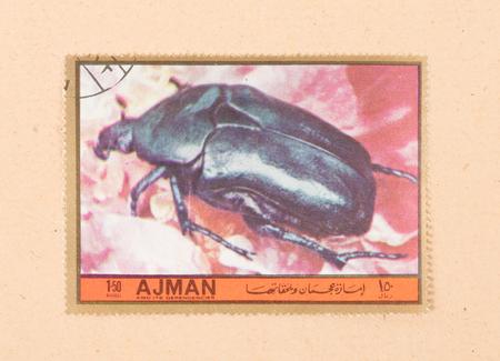 UNITED ARAB EMIRATES - CIRCA 1972: A stamp printed in the United Arab Emirates shows a beetle, circa 1972 Editorial