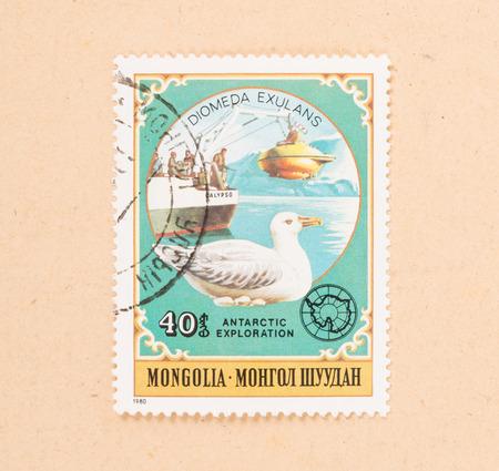 MONGOLIA - CIRCA 1980: A stamp printed in Mongolia shows a submarine, boat and a bird, circa 1980